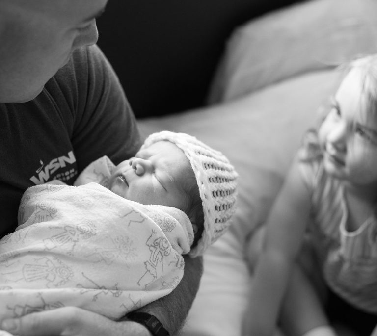 Birth photograph with dad and sibling